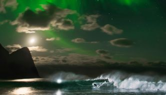 MICK FANNING UNDER NORTHERN LIGHTS